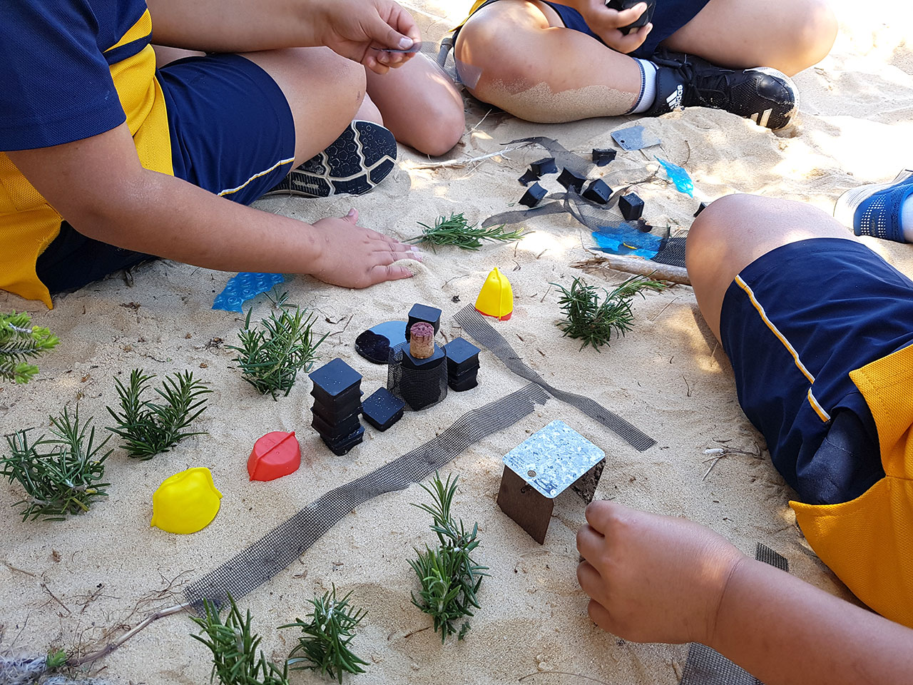 Close up of kids playing in sandpit
