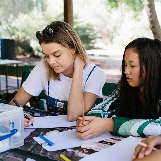 Isabella mentoring at a MK meeting